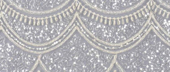 Stunning all-over laces, beaded trims and motifs, French Chantilly's, satin and bridal fabric