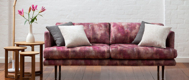Quilted upholstery with a lush textured weave and a pared back geometric design by Charles Parsons